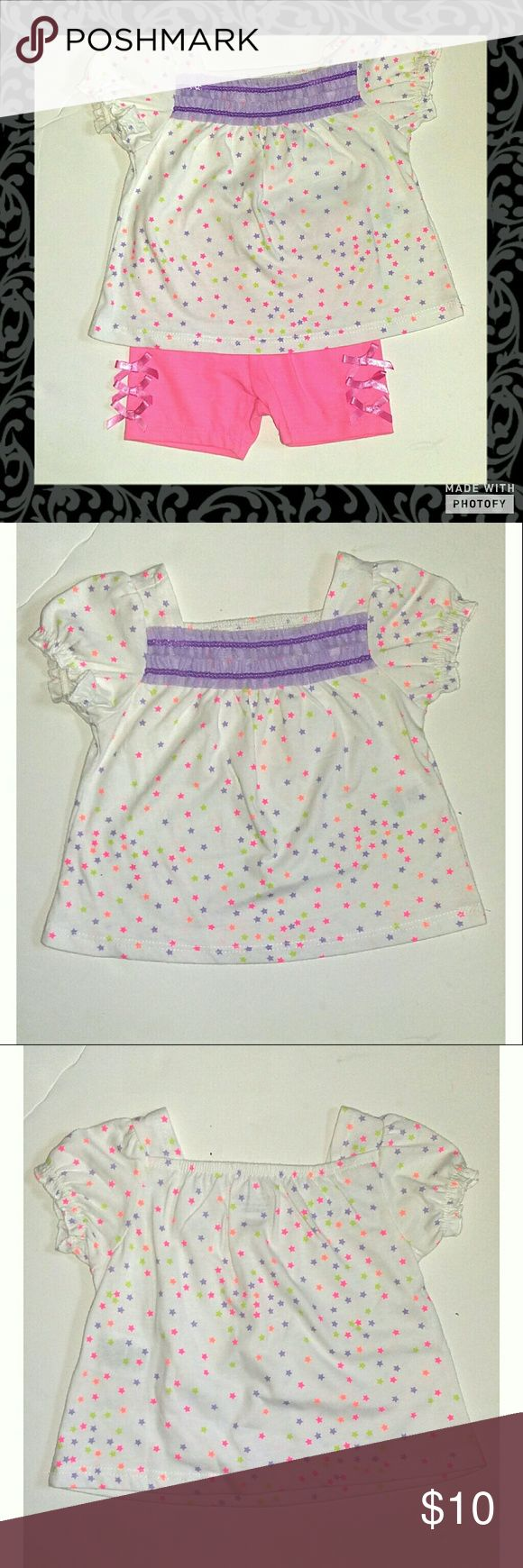 🍒2 For $15🍒Bright Stars Top & Shorts Outfit Top is white with little stars all over it and purple tule design on neck line. Shorts are bike shorts with little bows on the sides. New without tags. Size 12 months. Polyester cotton blend material. Wonder kids  Matching Sets