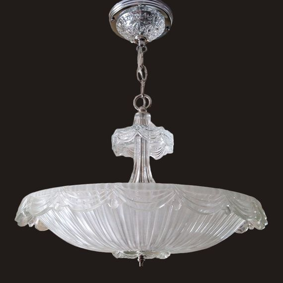Up for auction is this stunning art deco chandelier with a glass shade in a frosted