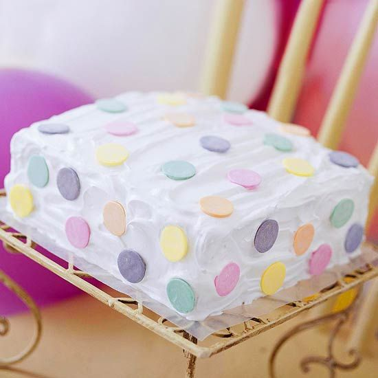 Make fun polka dot cake by adding some round wafer candies. It doesn't get easier than that! More adorable cakes: http://www.bhg.com/party/birthday/cake/birthday-cakes-and-cupcakes-for-girls/