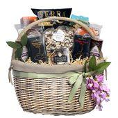 Purim Bounty gift basket. Oversized willow basket with gourmet caramels, teas, pistachios, chocolate cordials, popcorn, terra chips, biscott...