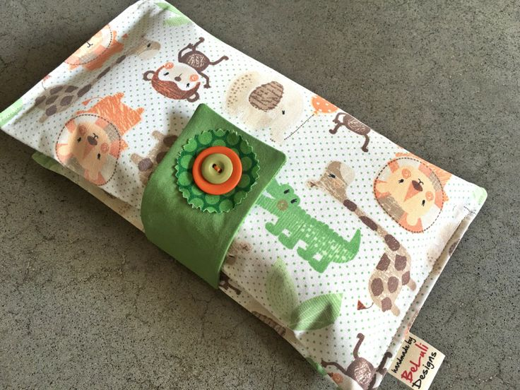 Baby or toddler funky nappy wallet. Cute Jungle Fun fabric. Custom made to create a unique item for you