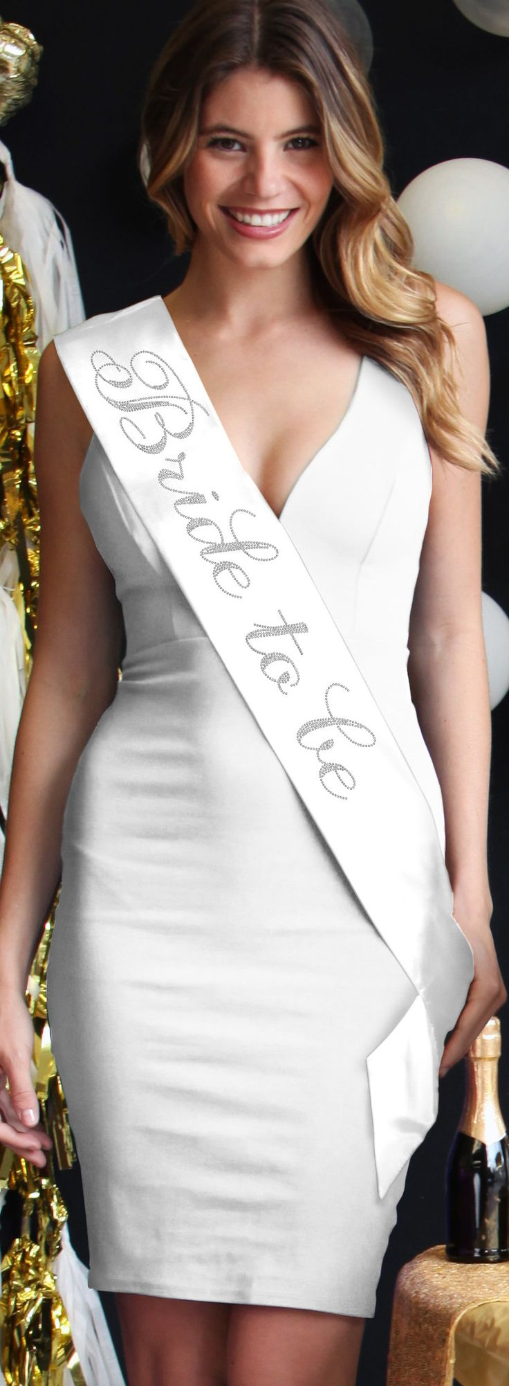 Tousles waves and a rhinestone Bride sash make this Bride to be a standout!