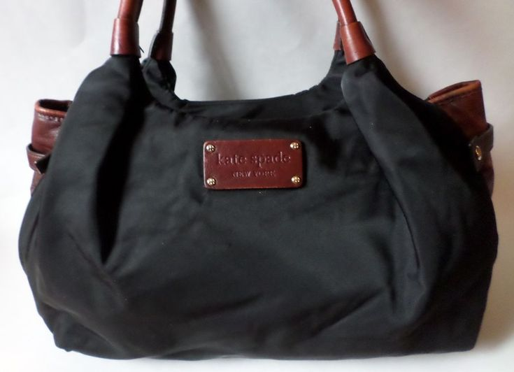 """Stevie"". Satchel / Tote / Diaper Bag. KATE SPADE. KATE SPADE Embossed Leather Bottom. Black Nylon. Double Leather Shoulder Straps -. Polka Dot Nylon Lined Interior. Brown Leather Trim. 