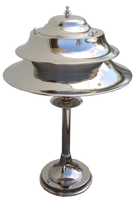 This large american art deco table lamp was made by the markel company of buffalo new york in the the lamp in brilliant nickel has a stepped base