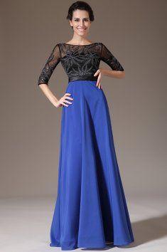Modro-černé společenské šaty s rukávy tylový živůtek zdobený nášivkou lodičkový výstřih a 3/4 rukávy bohatá splývavá sukně v kontrastní barvě všitá podprsenka a zip na zádech materiál je tyl a sametový šifon délka 155 cm od ramene k přednímu lemu