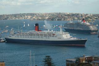 Click here for information on this QE 2 & Queen Victoria in Sydney 2008. You can buy handmade greeting cards with this photo for just $4.50 delivered. www.theshortcollection.com.au/Sydney