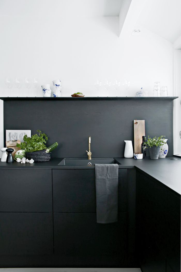 all black kitchen with open shelving