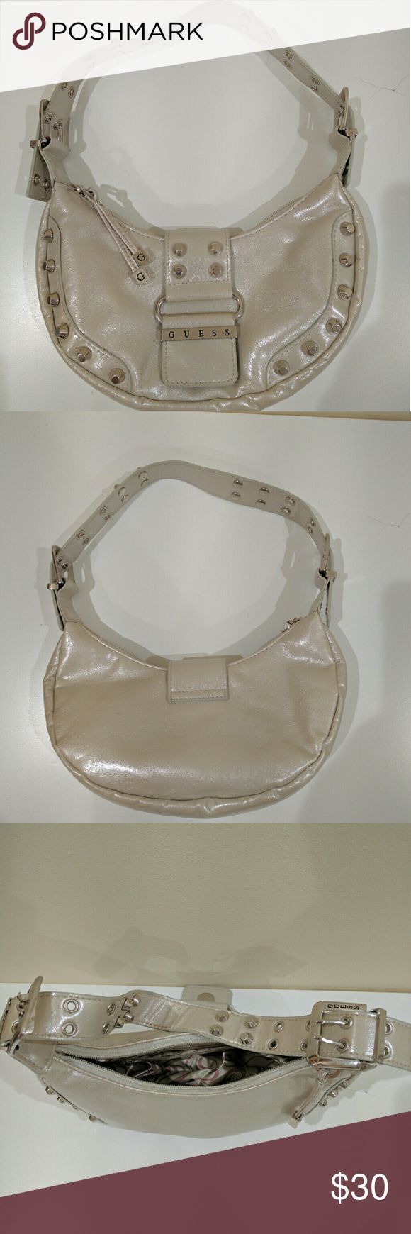 Guess Handbag Cool handbag. A little discoloration/imprint on the back as shown in the 3rd picture. Otherwise, it's in great condition! GUESS Bags Shoulder Bags