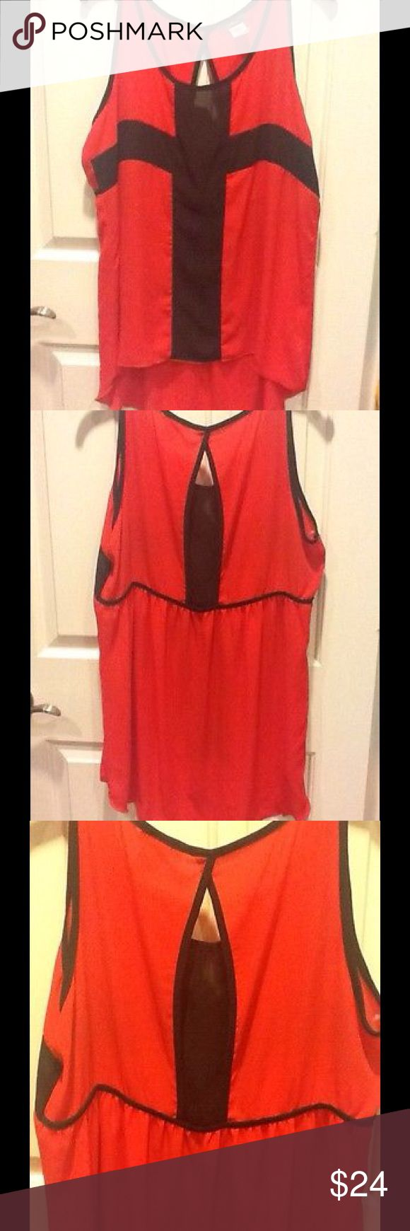 NWOT Plus Cross/Colorblock Tank/Top/Shirt~3XL NWOT Ladies Plus Red/Black Cross/Colorblock Sleeveless Tank/Top/Shirt~3XL ⚫️It is mostly solid, but in the front is has a black cross-like design or could be considered colorblock.🔴The back is an elongated like open keyhole shape!⚫️This also has a high-low hem. 🔴can be dressed up or paired w/ denim; beautiful w/ a denim cropped jacket/shrug/cardigan for cooler months & solo for the warmer months! ⚫️purchased in a boutique & was pricey & rare…