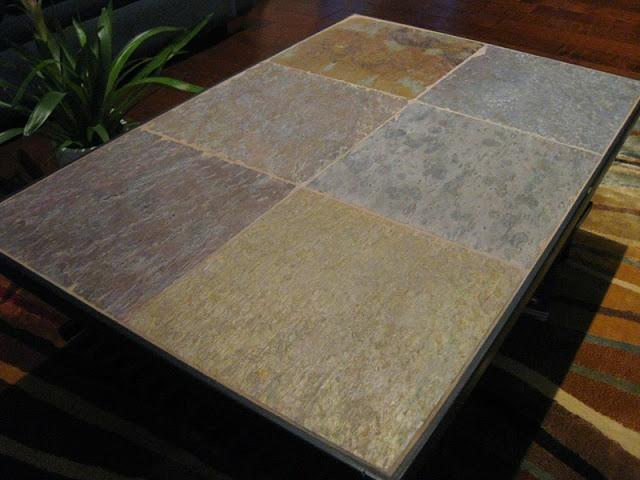 IkeaHacker DIY stone top coffee table made of shoe racks and slate tiles.