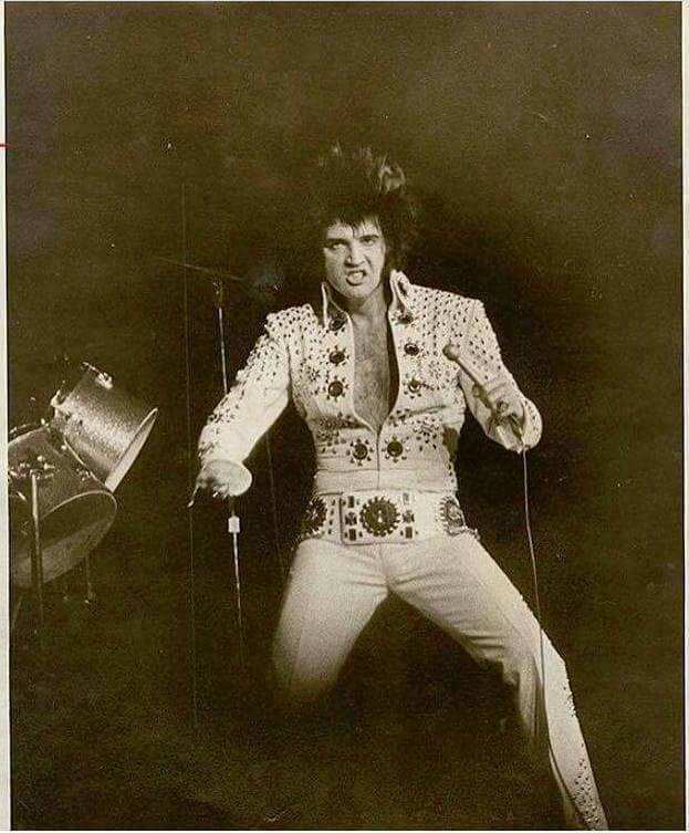 On Tour, November 5 - November 16, 1971 | Elvis Presley is pictured wearing the Snowflake Suit (aka Spectrum Suit because first worn at The Spectrum in Philadelphia, PA on November 8, 1971) live on stage in November 1971. This photo is either from his evening show (8:30 pm) on November 8, 13 or 16, 1971.