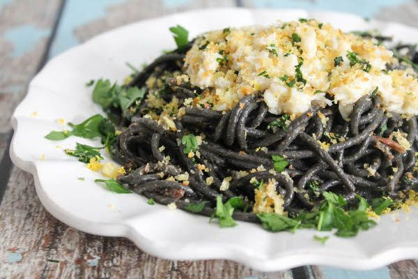 A luxurious homemade dish of squid ink pasta with buttered crab and gremolata breadcrumbs, inspired by a favorite dish in Domenica in New Orleans.