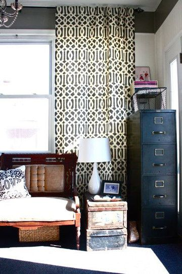 Again with the grey walls and white trim...love it with the patterned curtains. And industrial accents (notice the wire baskets, old trunk side table, blue file cabinets).