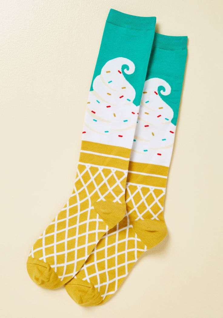 <p>There's no need to wait for the perfect moment to fall in your lap for flaunting these ice cream knee socks! You decide when the moment is right to fulfill your sweet style destiny, but if you're asking us, we find the opportune time to show off this pair's sprinkles, waffle cone, and aqua backdrop to be right now.</p>
