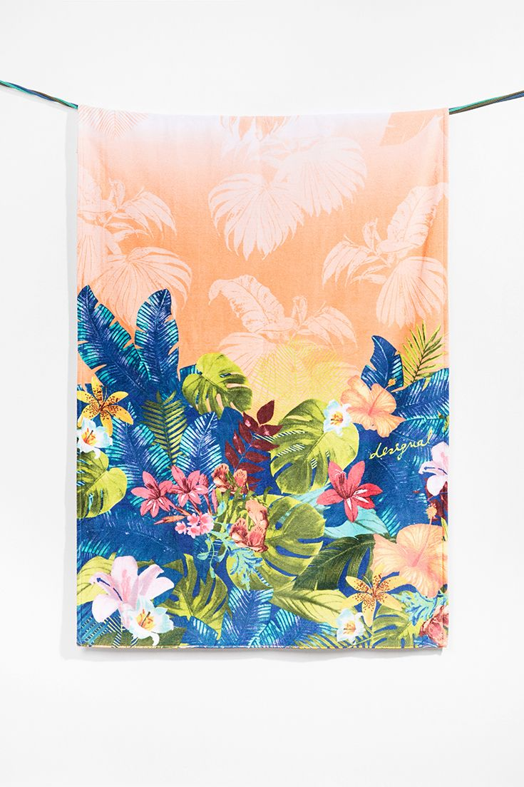 Desigual beach towel with a tropical flower print. You'll love how soft it feels! Discover Desigual Living collection!