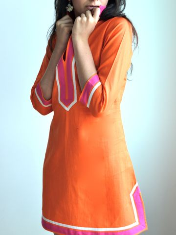 The Guru Palm Beach Linen Tunic can be everything and go everywhere with its pop of bold color and timeless fit.Guru's Linen Tunic is made of 100% European Linen, bought locally in NYC.Body of tunic is made of orange linen, and embellished with hand-st