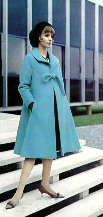 Model wearing a coat by Nina Ricci, 1963. Photo by Philippe Pottier.