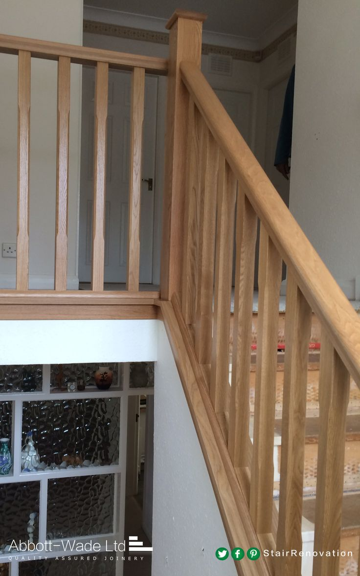 Chamfered oak spindles with oak newel posts and rails.