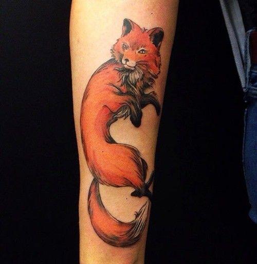 Cartoon like natural looking upper arm tattoo of fox