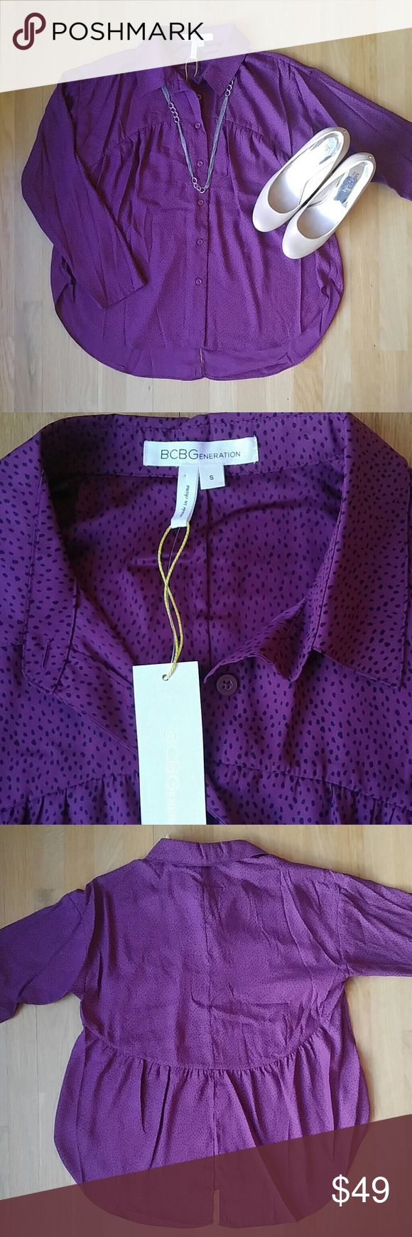 BCBGeneration Blouse NWT!!!! A beautiful purple and black speckled blouse. This top goes great with leggings or skinny jeans since it's flowy and blousey!! BCBGeneration Tops Blouses