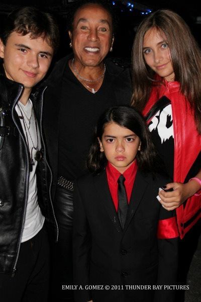 Michael Jacksons two sons Prince (aged 14) and Blanket (aged 9) and daughter Paris (aged 13) in October 2011 with Smokey Robinson.