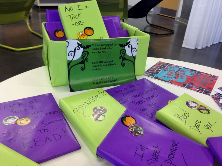 Trick or Treat Book Display! Teens can choose a book, check it out, and unwrap it when they get home. Will it be a trick or a treat? #libraryteens #trickortreat #yalibrary