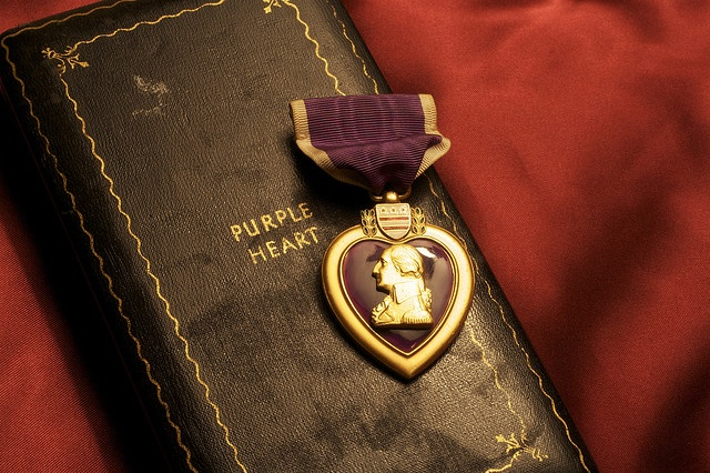 """Purple Heart  The Purple Heart is the oldest award that is still given to members of the U.S. military. It is awarded in the name of the President to those who have been wounded or killed while serving with the U.S. military. The original Purple Heart, designated as the Badge of Military Merit, was established by George Washington. The actual order includes the phrase, """"Let it be known that he who wears the military order of the purple heart has given of his blood in the defense of his…"""