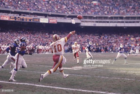 redskins jay schroeder | Rear view of Washington Redskins QB Jay Schroeder in action making ...