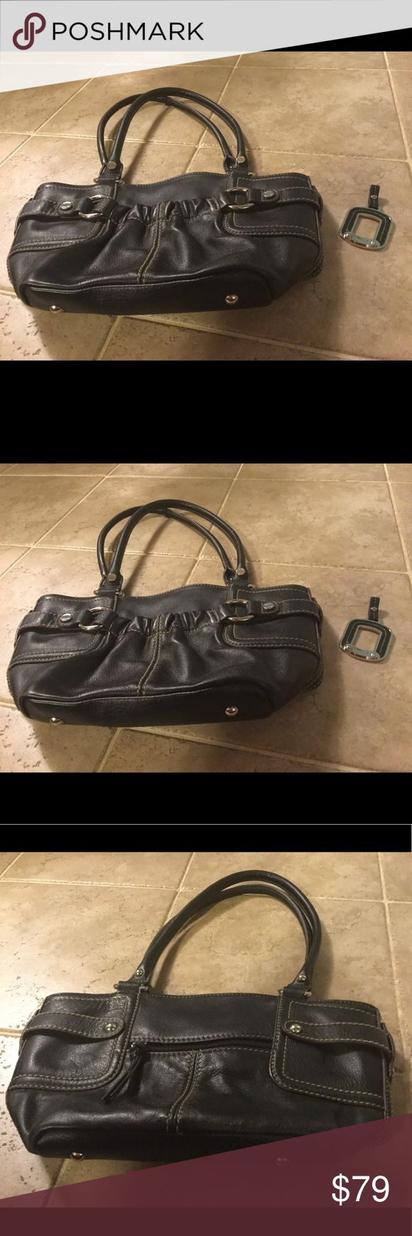 Tignanello Handbag Black leather Tiganello handbag in excellent used condition. Gorgeous silk lining. Also includes key chain. Tignanello Bags
