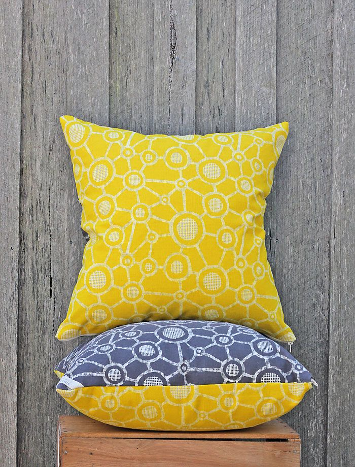 Joined Spot cushion in yellow, with grey joined spot backing. Available at www.designarthouse.com.au