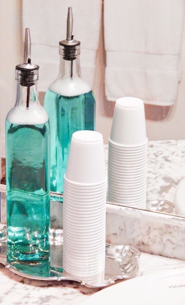 Decorative Bottles :     Put mouthwash in a container, with cups and on a cute tray for your bathroom sink. Genius.    -Read More –   - #DecorativeBottles https://decorobject.com/decorative-objects/decorative-bottles/decorative-bottles-put-mouthwash-in-a-container-with-cups-and-on-a-cute-tray-for-your-bathroom-sin/