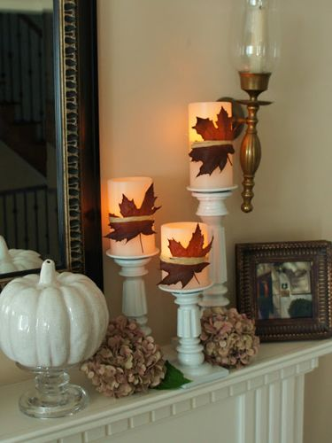 The standout item on this mantel couldn't be any easier to make: Simply affix backyard leaves to electronic candles by wrapping them with twine.