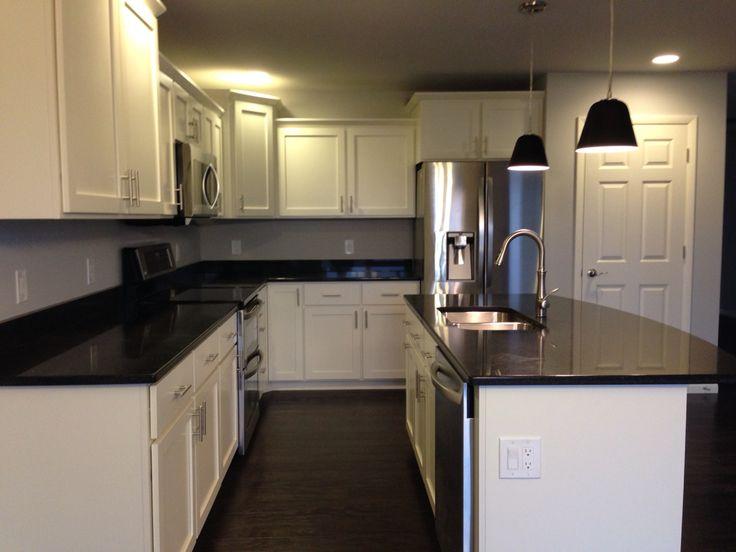 Kitchen With White Shaker Cabinets Black Quartz
