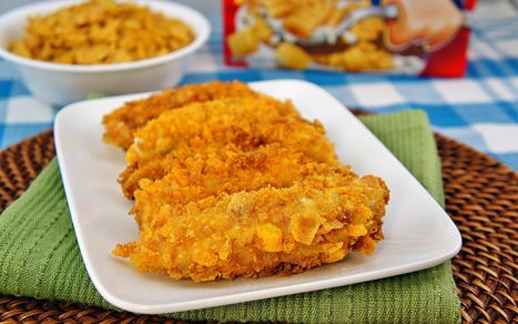 Planet Hollywood chicken tenders  2 cups Captain Crunch cereal  1 1/2 cup corn flakes  1 egg  1 cup milk  1 cup all-purpose flour  1 tsp onion powder  1 tsp garlic powder  1/2 tsp black pepper  2 lbs chicken breast cut in 1-oz tenders  vegetable oil for frying  http://www.momswhothink.com/chicken-recipes/captain-crunch-chicken-recipe.html