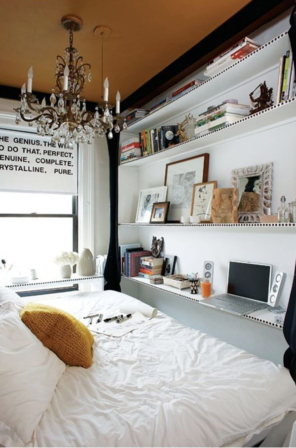 teeny tiny bedroom.  A great way to make a tiny room feel big.  like the stacked/layered shelving, also doubling the shelf as a desk/laptop prop