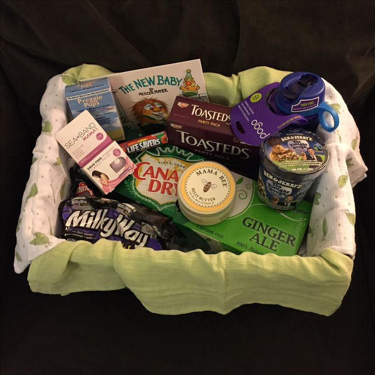Pregnancy survival gift basket:  Ginger Ale, crackers, mom's fave candy/treats, belly butter, preggie pops, nausea wrist band, water bottle, antacids, gender neutral swaddle blankets & outfit for baby, book/toy for older sibling-to-be