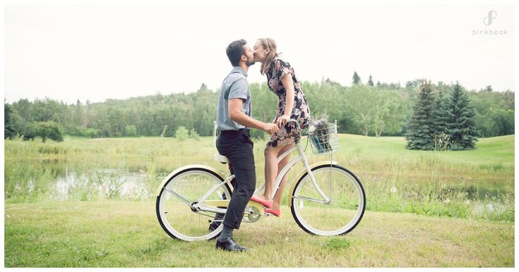 engagement couple photo on bicycle