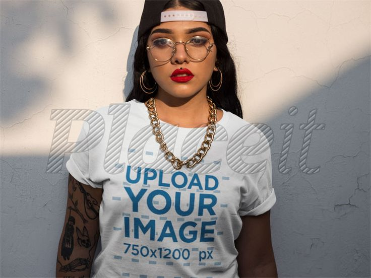 Hip Hop Girl Wearing a T-Shirt Mockup While Standing Against a Wall a17213Foreground Image