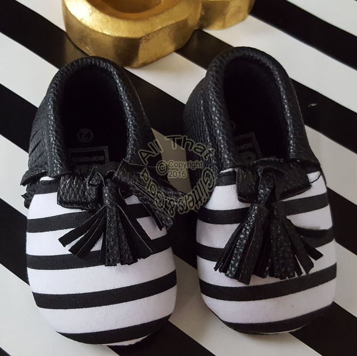 Black and White Striped Soft Soled Baby Girl Moccasin Shoes With Tassels Sizes 0 to 24 monthsLet these soft soled black and white striped slipper feet walk all over you! These soft soled baby girl moccasin shoes are so comfortable and stylish. These are designed with cute tassels and made with an elastic band so it will be easy to slip your little ones feet into. What Your Order Includes:1 Pair of Shoes----------------------------------------------------------------------------