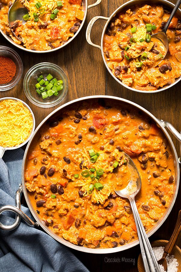 Buffalo Chicken Chili | Chocolate Moosey | Flavorful chili ready to eat in an hour? Why yes, it is possible with this Buffalo Chicken Chili recipe! Ground chicken, black beans, and hot sauce come together in this hearty one pot meal.