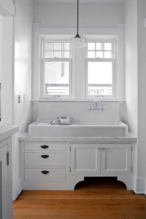 I do like the this sink. Only one ive seen like this that has a draining side. Also love the tap idea coming out the wall.