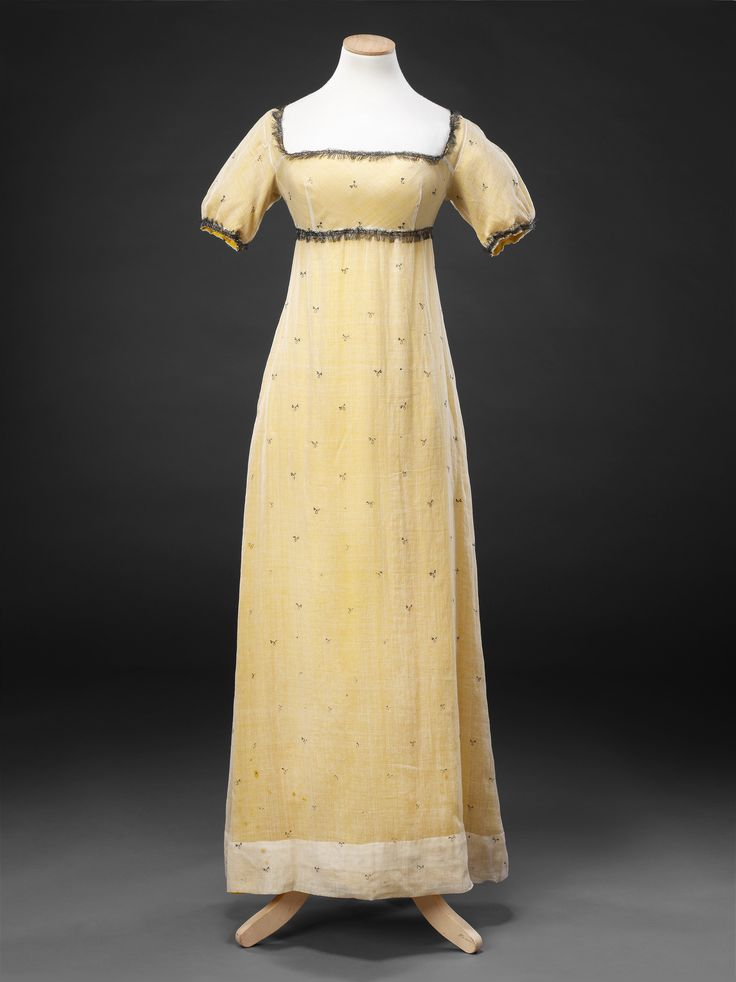 1810s Dress and Underdress; c.1810 Dress: Cotton muslin embroidered with metallic thread, trimmed with metallic fringe, over reproduction silk lining. (view 2)