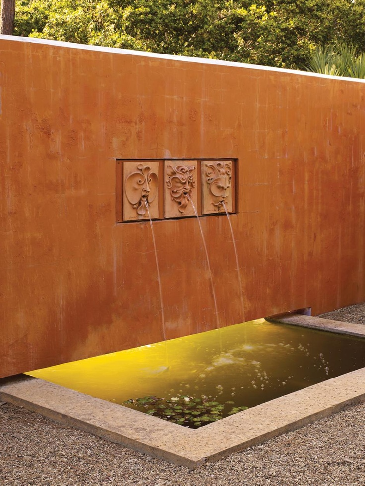 An unusual water feature with three different fountain heads - ancient meets modern.