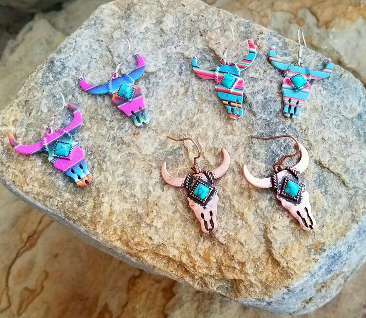 Serape and copper longhorn steer skull earrings!! Www.baharanchwesternwear.com