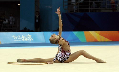 Rhythmic gymnastics is a sport in which individuals or teams of competitors (2 or more people) manipulate one or two pieces of apparatus: rope, clubs, hoop, ball, ribbon and Free (no apparatus). An individual athlete only manipulates 1 apparatus at a time. When multiple gymnasts are performing a routine together a maximum of two types of apparatus may be distributed through the group.   Source: http://www.ikgymnastics.com/