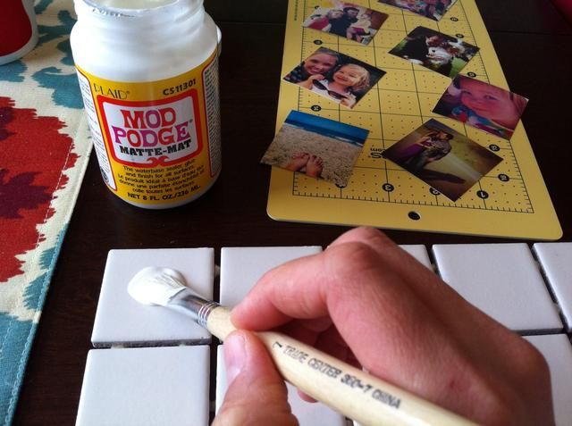 Apply enough Mod Podge to adhere an image to the surface of the tile. It dries clear, so don't worry about being a little messy.