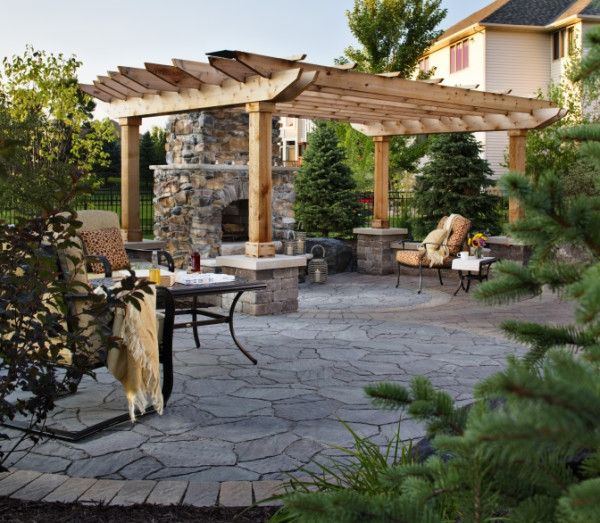 Natural elements - stone and wood - work beautifully together in this outdoor oasis.