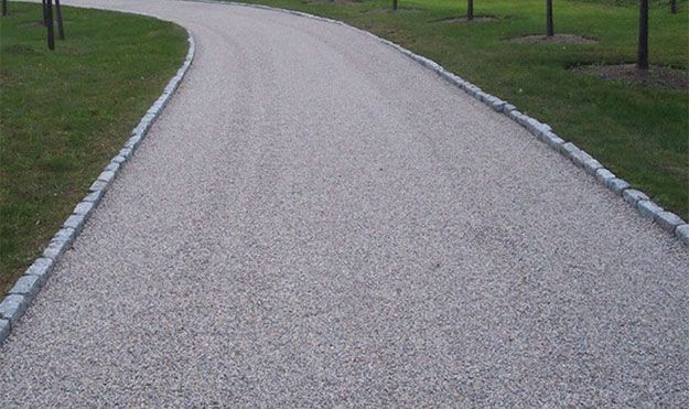 Tar and Chip Driveway from Atlanta    Tar & Chip Paving, also known as Chipseal, is a cost effective, yet attractive, driveway paving option. The Tar & Chip method combines asphalt and stone to create a textured hard surface. The end result is a driveway that provides more texture, giving the look and feel of traditional gravel but is much stronger and durable and will blend with the natural surroundings.