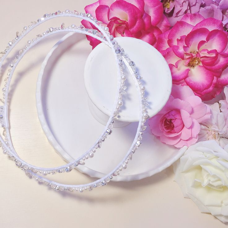 Another beautiful, refined and delicate set of couture Stefana hand beaded with SWAROVSKI crystals and pearls. Pure white elegance with a subtle touch of crystal, silver tones and white pearl. #nomikiglynatsiscouture #ngc #swarovski #crystals #whitepearl #white #satinribbon #stefana #weddingcrowns #wedding #bridal #usabound #luxury #luxurywedding #floral #floraldecorations #rose #vscocam
