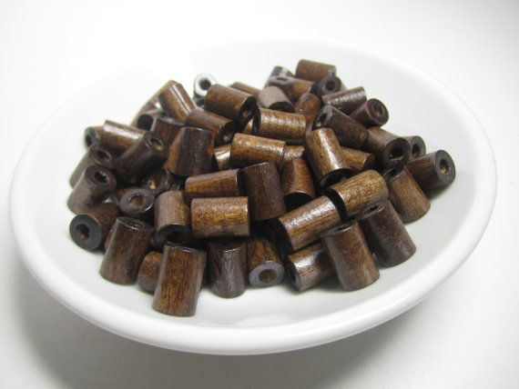 Hey, I found this really awesome Etsy listing at https://www.etsy.com/listing/189981657/dark-wood-tube-beads-100-pcs-wooden-tube
